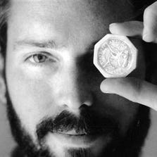 In this November 1989 photo, Tommy Thompson holds a $ 50 pioneer gold piece retrieved earlier in 1989 from the wreck of the gold ship Central America. Thompson led a group that recovered millions of dollars worth of sunken treasure only to end up involved in court cases brought by dozens of insurance companies laying claim to the treasure.
