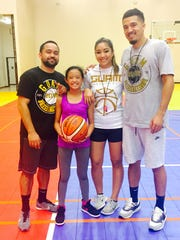 Fifth-grader Jordyn Zacarias is flanked by her coaches