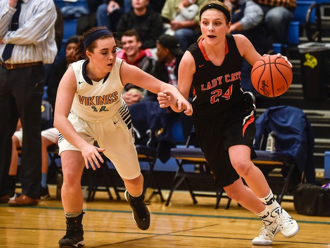North Union's Taylor Day tries to get around River