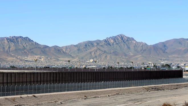 The current border fence weaves through East El Paso.