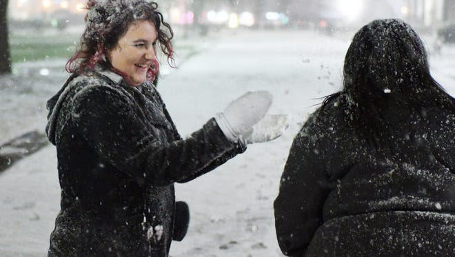 Southern Miss freshman Reed Wolfram throws a snowball at her friend as severe winter weather comes to Hattiesburg on Tuesday.