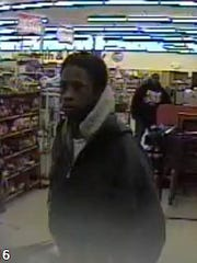 Male suspect described as 6 foot tall African-American, aged 25-35, and wearing a blue jacket and blue jeans.