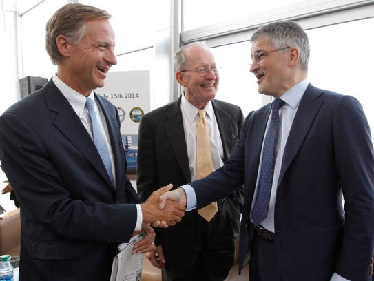 Gov. Bill Haslam, left, speaks to U.S. Sen. Lamar Alexander,