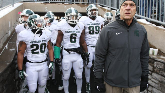 Michigan State Spartans head coach Mark Dantonio stands in the tunnel with his players prior to the game against the Penn State Nittany Lions at Beaver Stadium.