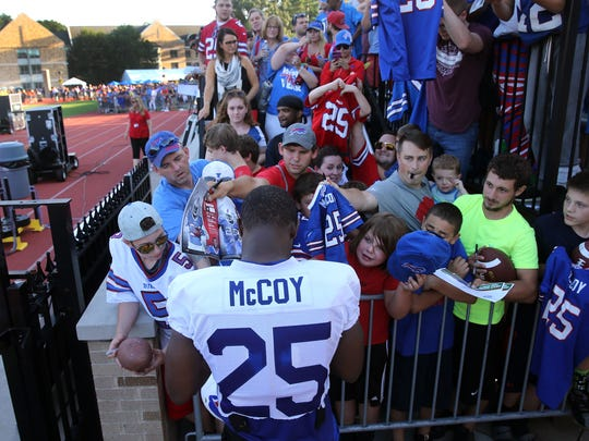 Bills running back LeSean McCoy is swarmed by fans after the first night of training camp at St. John Fisher College.