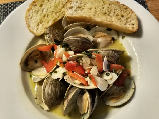 Drift Kitchen & Bar's Cedar Key middle neck clams in a broth of lemongrass, garlic, ginger, and cilantro.