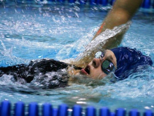 South Lyon Unified's Megan Mieske swims the backstroke.