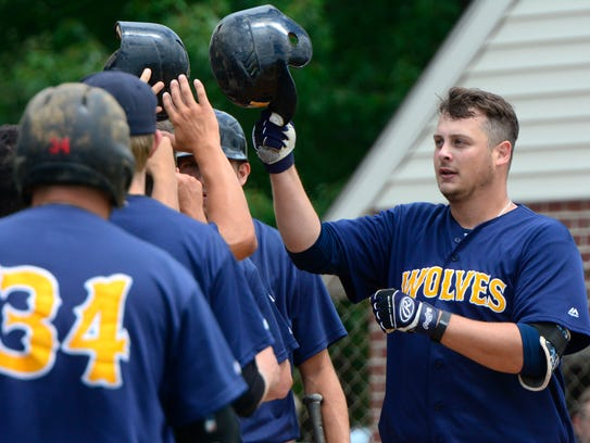 Mount Wolf's Steve Pokopec is greeted by his teammates