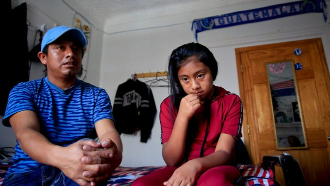 Manuel Marcelino Tzah, left, and his daughter Manuela Adriana sit inside their apartment during an interview hours after her release from immigrant detention Wednesday in Brooklyn, N.Y. The Guatemalan asylum seekers were separated May 15 after they crossed the U.S. border in Texas.