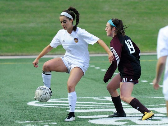 Wylie midfielder Gracie McCaslin (4) settles the ball in front of Brownwood's Khloe Tobien (19) during the Lady Bulldogs' 1-0 win in the Region I-4A quarterfinals at Shotwell Stadium on Friday, April 6, 2018.