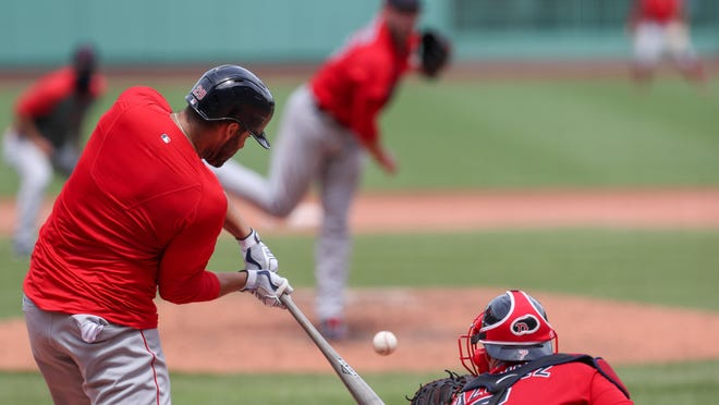 Red Sox designated hitter J.D. Martinez, who had three hits, drills a home run during Friday's instrasquad game at Fenway Park.