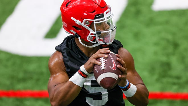 Georgia quarterback Jamie Newman (9) during the Bulldogs' practice in Athens, Ga., on Mon., Aug. 17, 2020.
