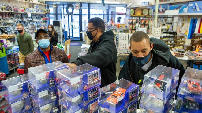 From right, Mychael Douglas, Myron Johnson and Bruce Wilson browse remote-controlled RC cars Friday afternoon at Dee & Mee Hobbies, 5331 S.W. 22nd Place. The toy store has seen a significant increase in sales during the pandemic.