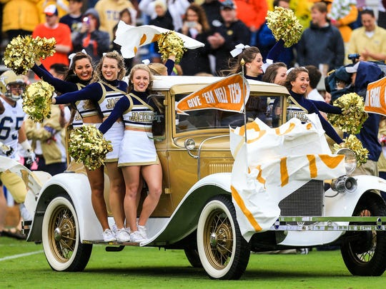 The Georgia Tech Yellow Jackets cheerleaders on the Ramblin Wreck comes on the field before the game against Syracuse at Bobby Dodd Stadium.