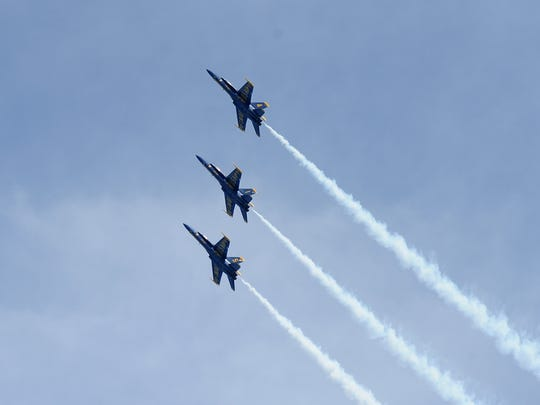 Three Blue Angels F/A-18 Hornets fly in formation over lake Michigan during the 2017 Milwaukee Air & Water Show.