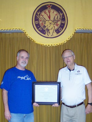 Mountain Home Elks Lodge President Don Swanson, right, recently presented Elk member Brent Baker the President's Lifetime Achievement Award signed by President Obama. The award recognizes lifetime achievement in volunteerism, honoring those who have provided more than 4,000 hours of volunteer service over the course of their lifetime. Baker has volunteered more than 6,000 hours with the Hospice of the Ozarks, as well as other organizations.