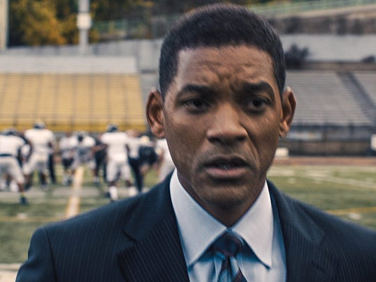 """AP Will Smith plays Dr. Bennet Omalu, in Columbia Pictures' """"Concussion."""" This image provided by Columbia Pictures shows, Will Smith as Dr. Bennet Omalu, in a scene from Columbia Pictures' """"Concussion."""" The movie releases in U.S. theaters on Dec. 25, 2015. (Columbia Pictures via AP)"""