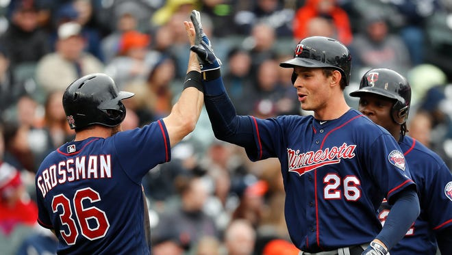 Minnesota Twins' Max Kepler (26) celebrates his three-run home against the Detroit Tigers with Robbie Grossman (36) in the fifth inning of a baseball game in Detroit, Thursday, April 13, 2017.