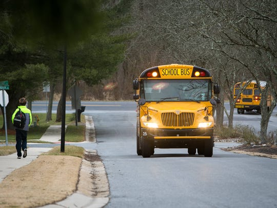 School buses drop students off in Hockessin. The Red Clay Consolidated School District announced this week that not only will it be reorganizing bus routes but changing school start times.