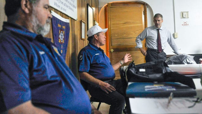 Vietnam Veterans of America Chapter 1117 Secretary Randy Drazba speaks during a visit by U.S. Rep. Jim Jordan (right) at VFW Post 7201 Monday. Chapter president Bob Coy is at left.