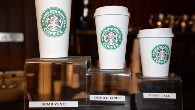 """""""Dumb"""" venti, grande and tall cups are displayed inside """"Dumb Starbucks"""" coffee shop, on Feb. 10, 2014, in the Los Feliz area of Los Angeles."""