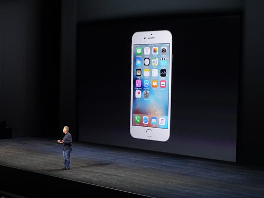 Phil Schiller shows off new iPhone.