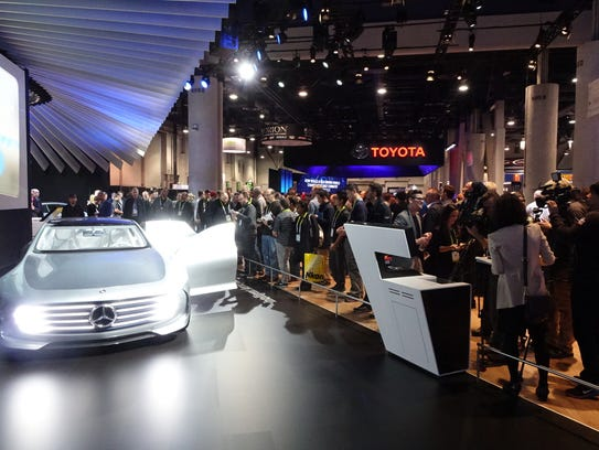 Crowds checking out a new Toyota at CES 2016