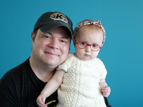 Comedian John Caparulo and baby Madden in the USA TODAY