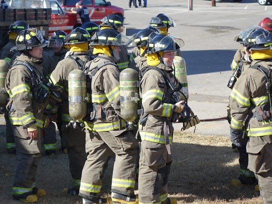 New firefighters await their turn to battle first time.