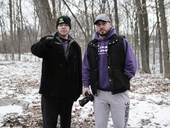 Lucas Holliday, left, has experience shooting music videos in Lansing with Nicholas Bozzo, owner of Crack House Recording Studio. Holliday is seen here giving a hand signal that shows pride for the city.
