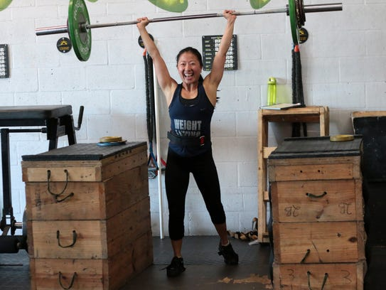 Naples weightlifter Janet Chow reacts to lifting a