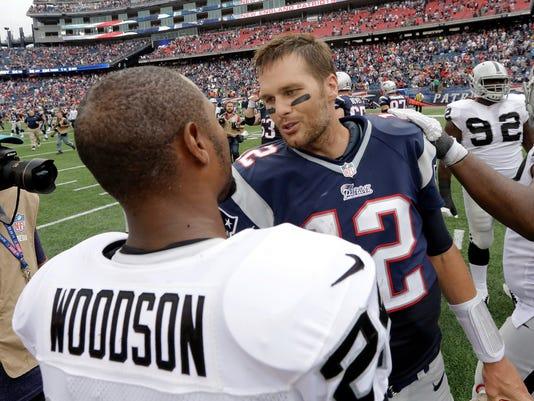 635581217124124360-AP-Raiders-Patriots-Football