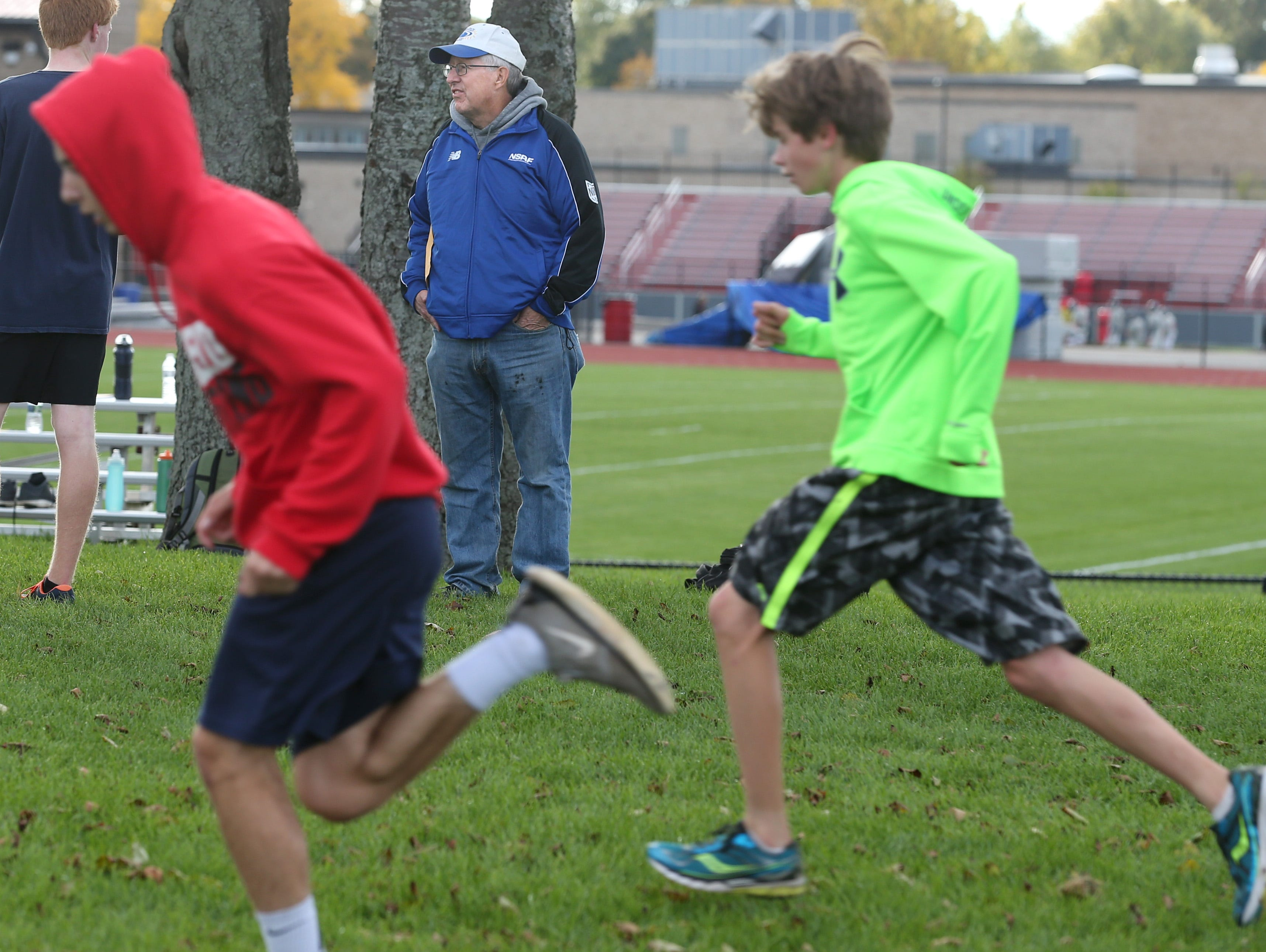 Dave Hennessey, cross country coach at Penfield High School, at practice on Oct. 14, 2015.