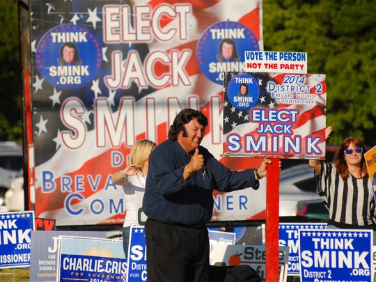 Jack Smink, candidate for Brevard County Commissioner, District 2 (and an Elvis Presley tribute artist) on election day in Brevard, waving to motorists.