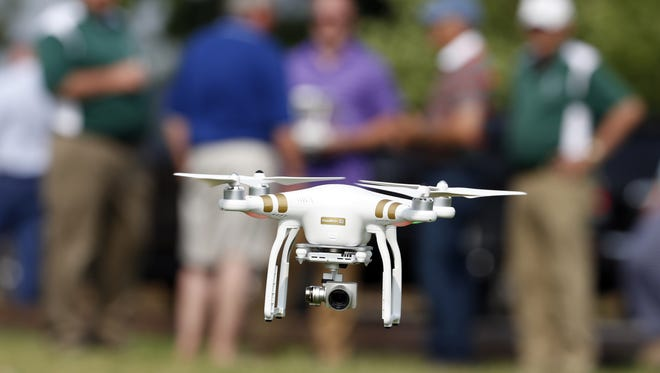 A DJI Phantom 3 drone is flown during a drone demonstration at a farm and winery, on potential use for board members of the National Corn Growers, Thursday, June 11, 2015 in Cordova, Md.