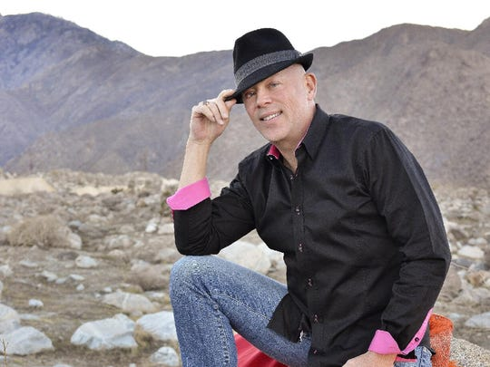 Entertainer Michael Holmes strikes a pose in the desert with one of the glamorous frocks he wears during his show at The Purple Room Restaurant and Stage in Palm Springs.