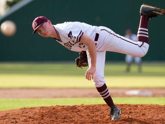 Henderson County's Sam Elliott delivers a pitch to