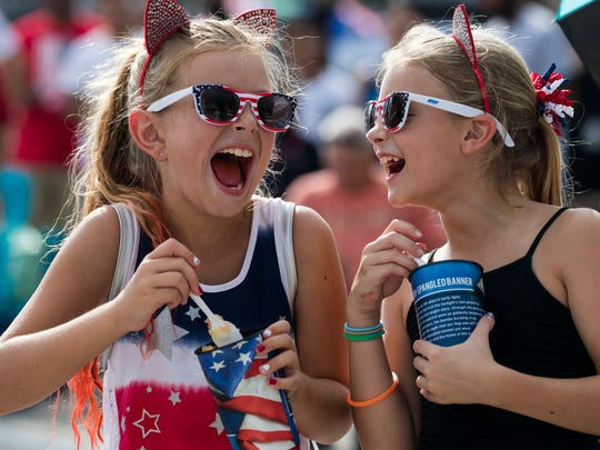 Kaylin Zelenak and Audrina Ische celebrated Cape Coral's Red, White and Blue celebraton of the Fourth of July in 2018.  There will be no Red, White and Boom on Independence Day this year. The coronavirus has prompted officials to delay the event until Sept. 5, Labor Day weekend, if it is deemed safe.