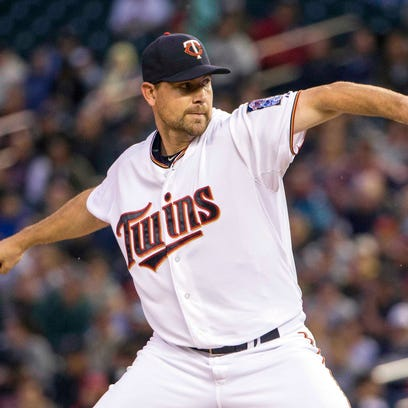 Twins starting pitcher Mike Pelfrey delivers a pitch