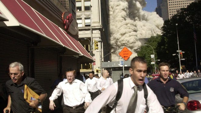 Stephen Cooper, who died March 28 in Palm Beach County from coronavirus, achieved an element of fame on 9/11 when he was photographed, with yellow envelope under arm, fleeing the collapsing south tower of the World Trade Center.