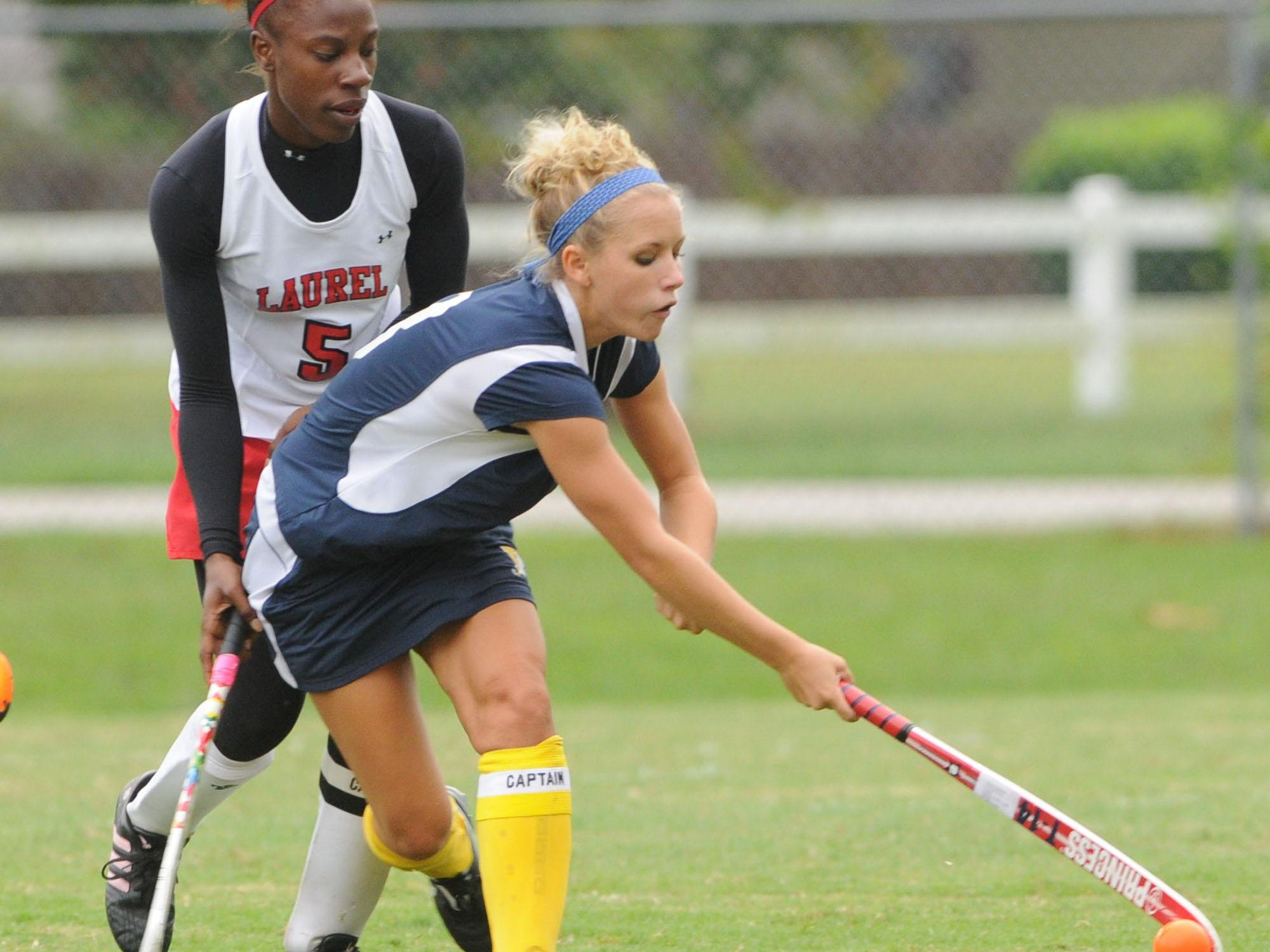 Pocomoke's Michelle Roberts drives against Laurel's Tomarrow Briddell in this 2009 photo.
