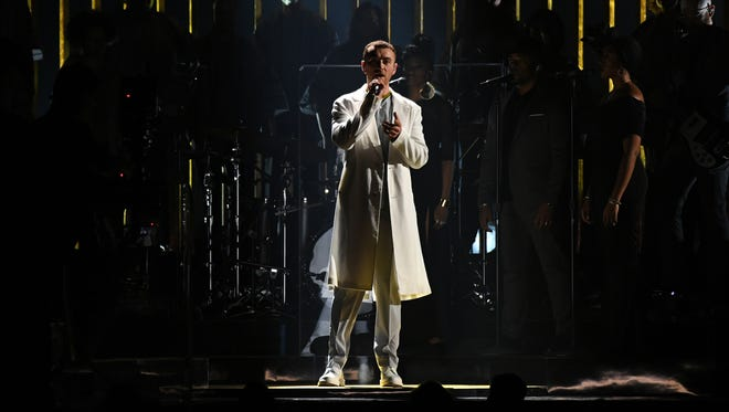 """Sam Smith performs """"'Pray""""' in a white outfit that Twitter poked fun of."""