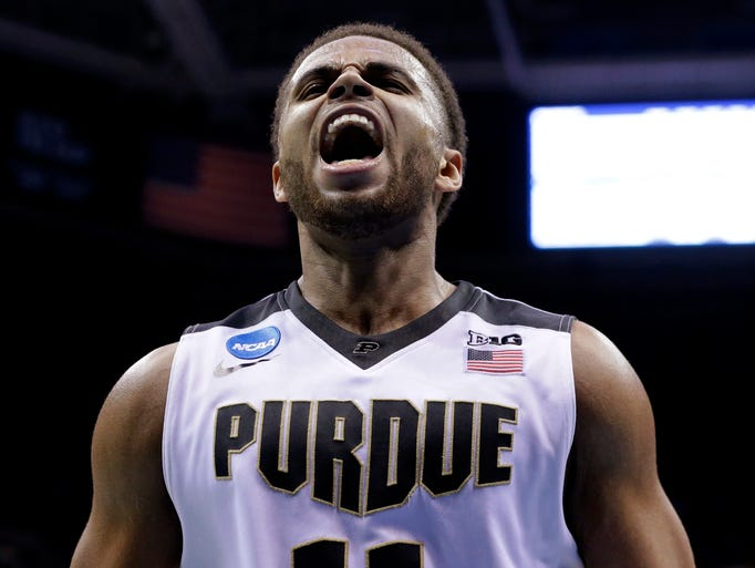 Purdue guard P.J. Thompson (11) reacts after being