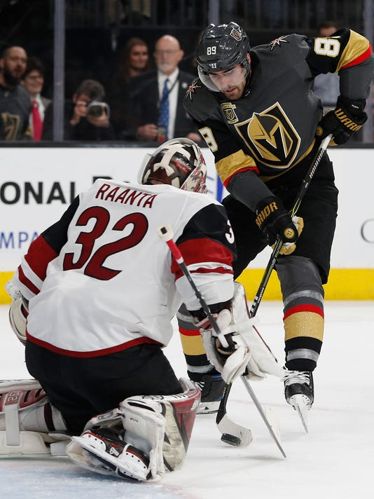 Vegas Golden Knights right wing Alex Tuch tries to score against Arizona Coyotes goaltender Antti Raanta during the second period of an NHL hockey game, Wednesday, March 28, 2018, in Las Vegas. (AP Photo/John Locher)