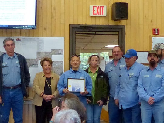 Lee stands with members of the Solid Waste Department, which was named department of the quarter in Ruidoso.