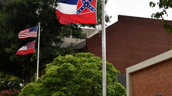 The U.S. flag and the Mississippi state flags fly outside the Mississippi Prison Industries Corp. buildings on State Street in Jackson.