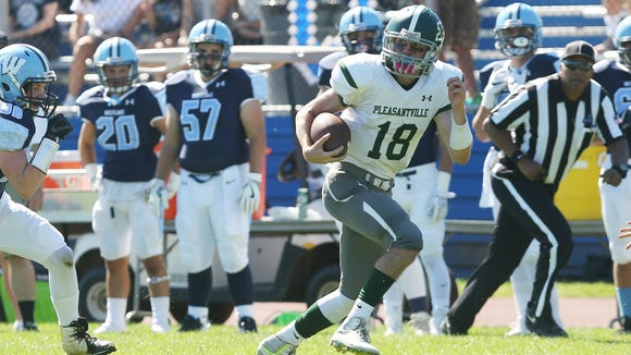 Pleasantville quarterback Jack Howe (18) runs for his first of two first half touchdowns against Westlake during football action at Westlake High School in Thornwood Sept. 23,  2017.