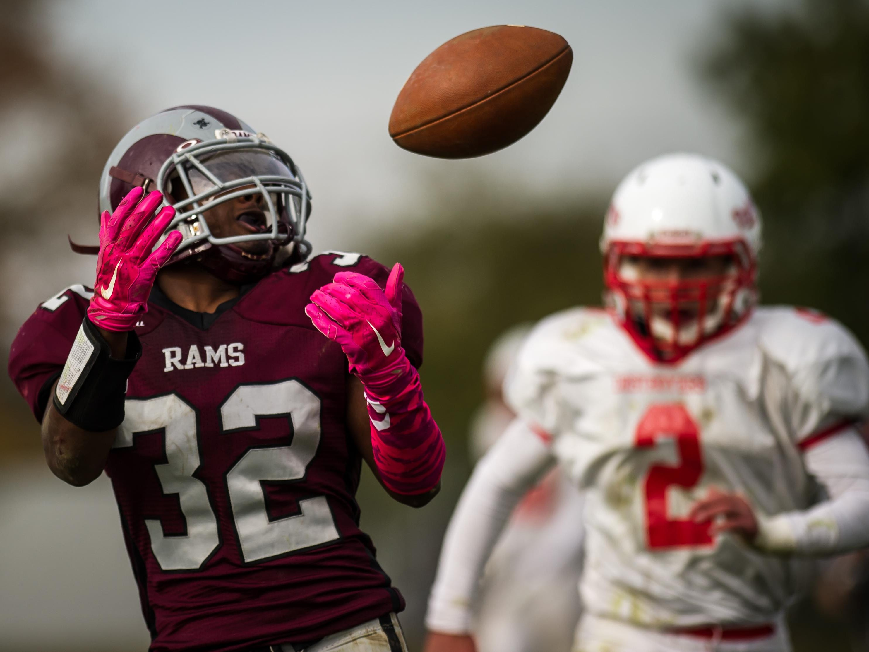 South River's Khaliyl Everett looks to make a reception in front of Dunellen's Mike Harmon in the second quarter of their game on Sat. Oct. 31, 2015 in South River. Photo by Jeff Granit