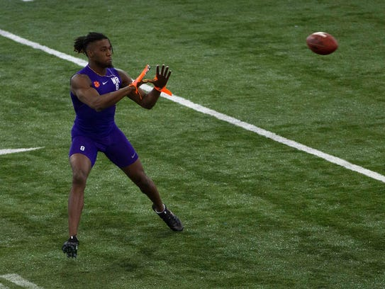 Former Clemson wide receiver Deon Cain (8) works out