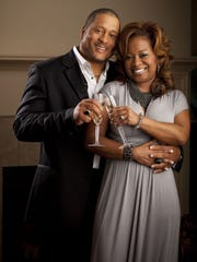 """Pat and Gina Neely in 2011 toasting the release of """"The Neelys"""" Celebration Cookbook.""""  The couple filed for divorce in 2014."""